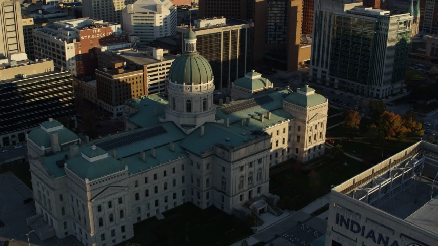 5.7K stock footage aerial video flying by and away from the Indiana State House in Downtown Indianapolis, Indiana Aerial Stock Footage | DX0001_002912
