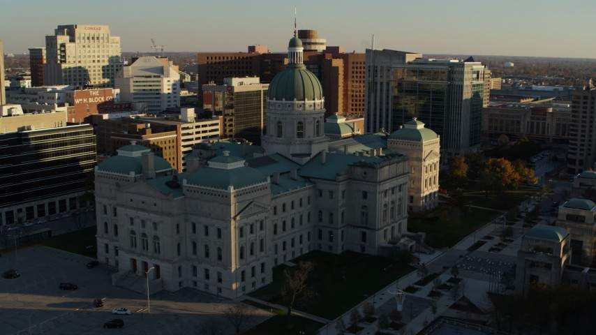 5.7K aerial video orbit the Indiana State House in Downtown Indianapolis, Indiana while descending Aerial Stock Footage DX0001_002913