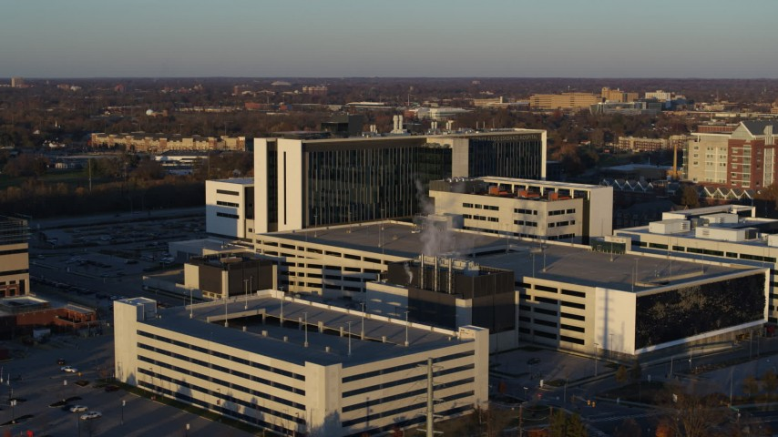 5.7K stock footage aerial video of orbiting a large hospital complex at sunset in Indianapolis, Indiana Aerial Stock Footage | DX0001_002917