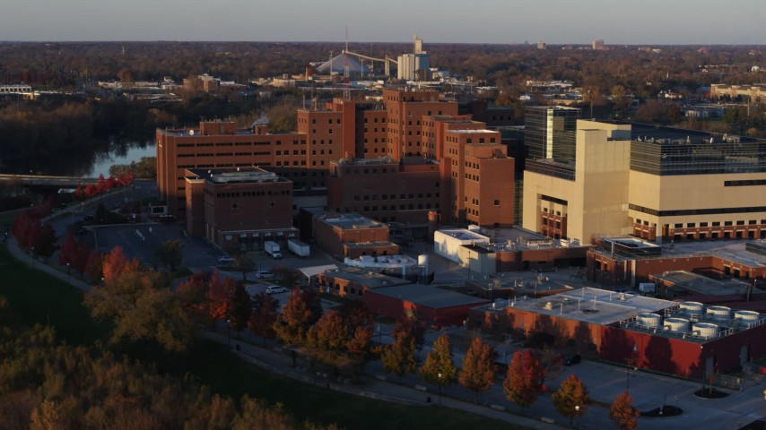 5.7K aerial video approach and orbit a VA hospital complex at sunset in Indianapolis, Indiana Aerial Stock Footage | DX0001_002919