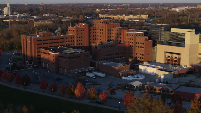 5.7K stock footage aerial video pass and fly away from a VA hospital complex at sunset in Indianapolis, Indiana Aerial Stock Footage | DX0001_002920