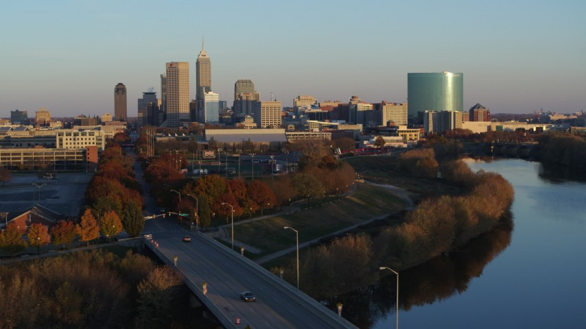 5.7K aerial video of the city's skyline seen from the White River at sunset, Downtown Indianapolis, Indiana Aerial Stock Footage | DX0001_002921
