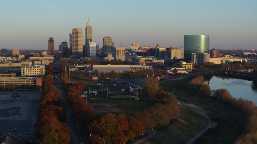 5.7K stock footage aerial video of the city's skyline seen from the White River at sunset, Downtown Indianapolis, Indiana Aerial Stock Footage | DX0001_002922