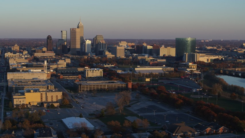 5.7K stock footage aerial video of a view of the city's skyline at sunset, Downtown Indianapolis, Indiana Aerial Stock Footage | DX0001_002923