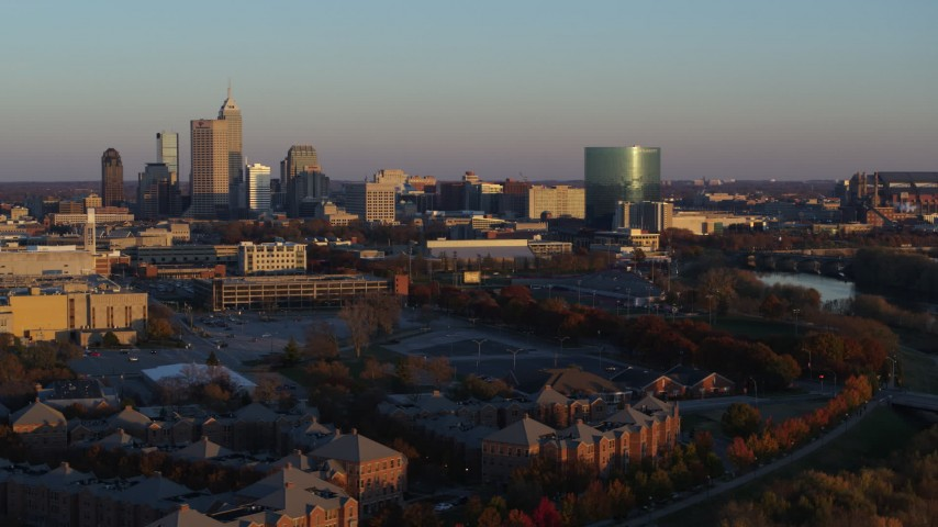5.7K aerial video of flying by the city's skyline at sunset, Downtown Indianapolis, Indiana Aerial Stock Footage | DX0001_002928