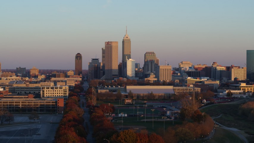 5.7K aerial video of a wide view of the city's skyline at sunset, Downtown Indianapolis, Indiana Aerial Stock Footage | DX0001_002932