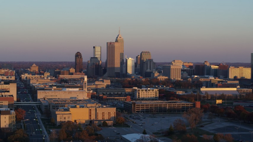 5.7K stock footage aerial video of a wide view of the city's downtown skyline at sunset, Downtown Indianapolis, Indiana Aerial Stock Footage | DX0001_002933