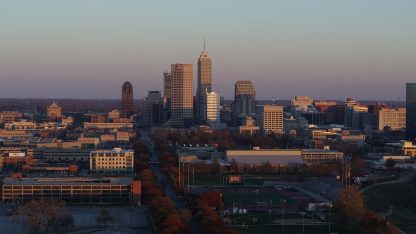 5.7K aerial video descend with wide view of the city's downtown skyline at sunset, Downtown Indianapolis, Indiana Aerial Stock Footage | DX0001_002935