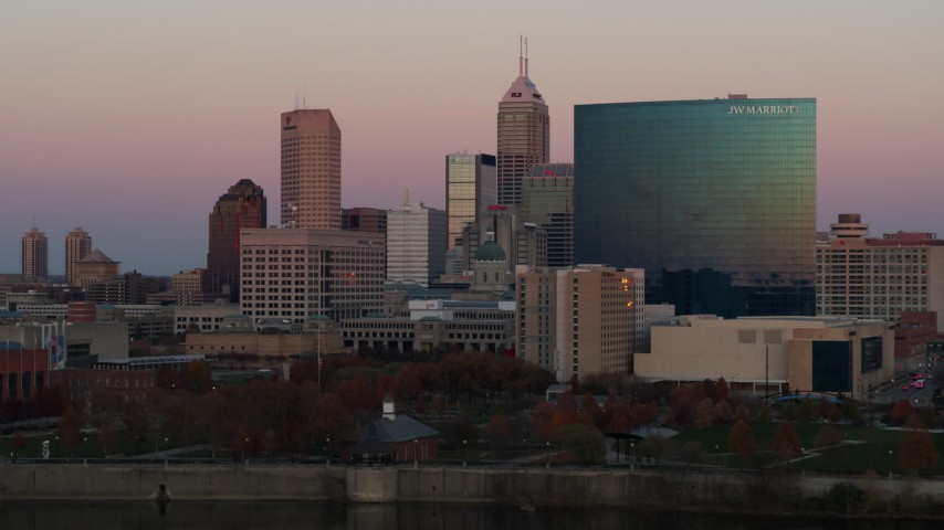 5.7K aerial video flyby hotel for view of the city's skyline at sunset, Downtown Indianapolis, Indiana Aerial Stock Footage | DX0001_002937
