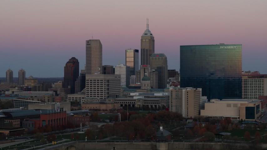 5.7K stock footage aerial video of ascending near city's skyline and hotel at sunset, Downtown Indianapolis, Indiana Aerial Stock Footage | DX0001_002944