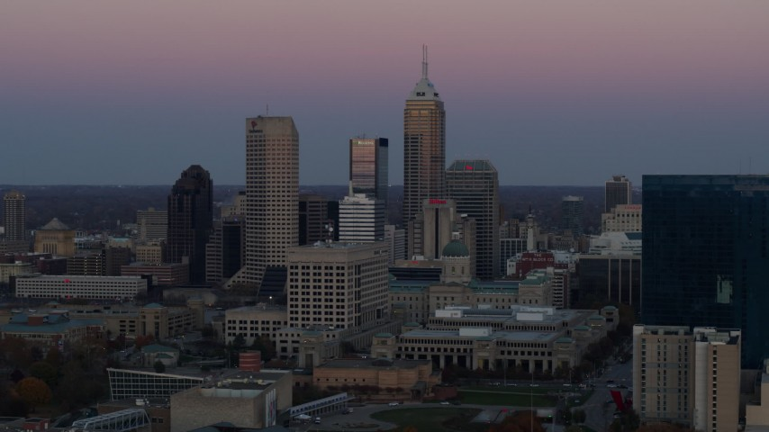 5.7K stock footage aerial video of a reverse view of the city's skyline at sunset in Downtown Indianapolis, Indiana Aerial Stock Footage | DX0001_002947