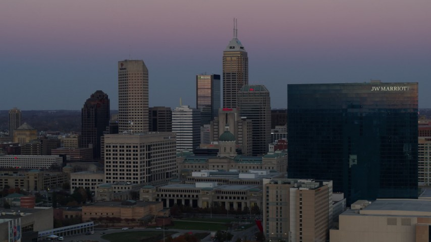 5.7K stock footage aerial video slowly flyby the city's skyline and a hotel at sunset in Downtown Indianapolis, Indiana Aerial Stock Footage | DX0001_002950