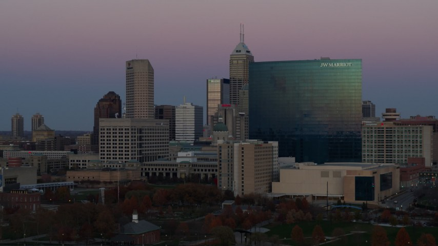 5.7K stock footage aerial video slowly flyby a hotel at sunset with skyline in background, Downtown Indianapolis, Indiana Aerial Stock Footage | DX0001_002951