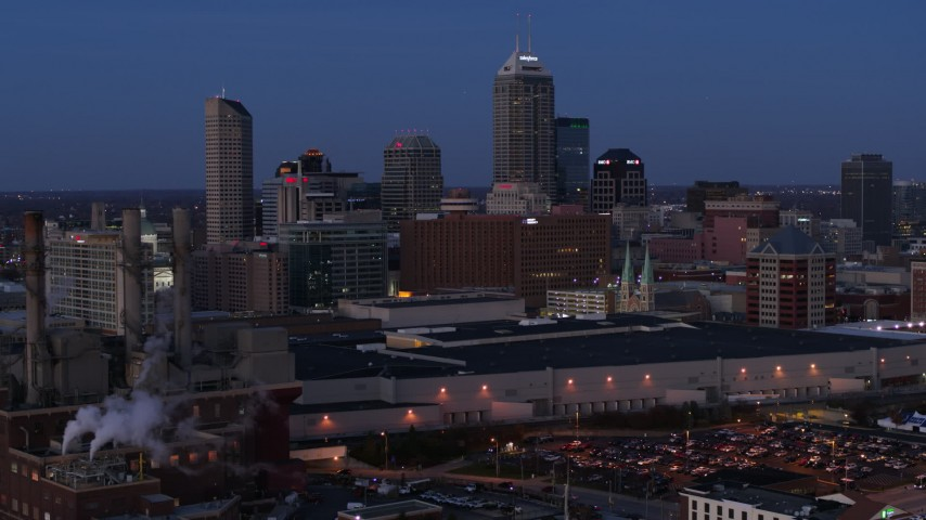5.7K stock footage aerial video slowly pass smoke stacks at twilight with skyline in background, Downtown Indianapolis, Indiana Aerial Stock Footage | DX0001_002963