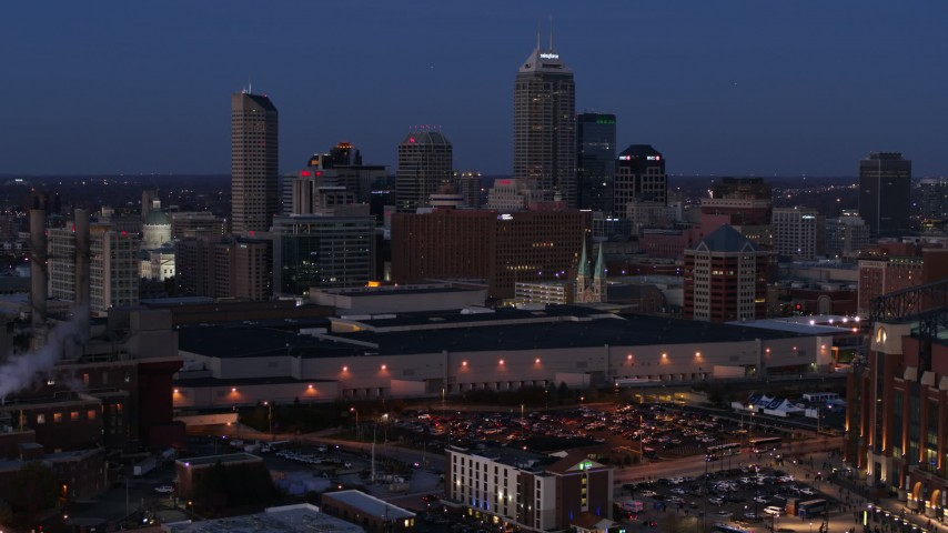 5.7K stock footage aerial video the city skyline behind convention center at twilight, Downtown Indianapolis, Indiana Aerial Stock Footage | DX0001_002967