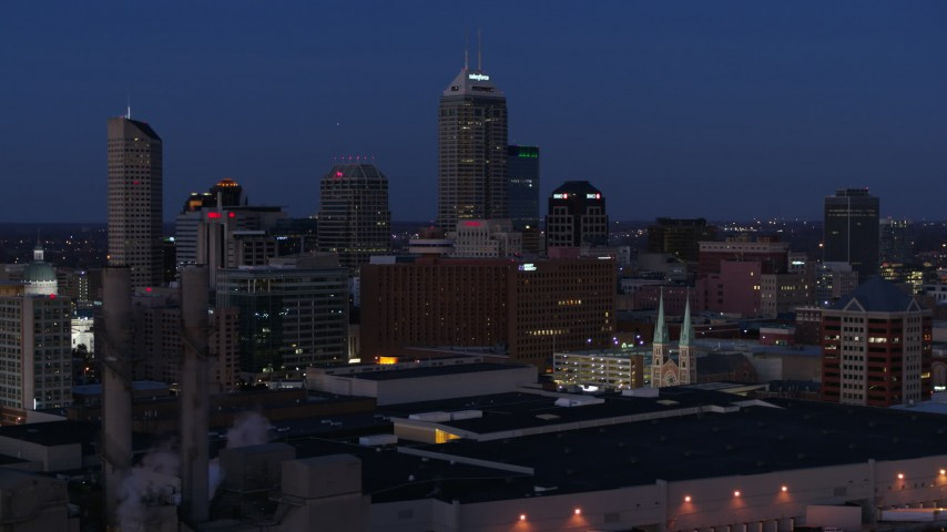 5.7K stock footage aerial video the giant skyscrapers of the city skyline at twilight, Downtown Indianapolis, Indiana Aerial Stock Footage | DX0001_002969