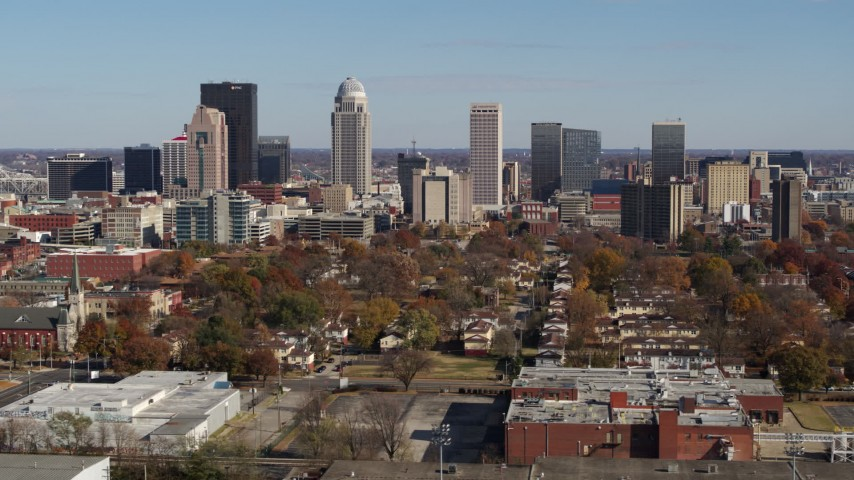 5.7K aerial video of slowly flying away from and by the city's skyline, seen from apartment buildings, Downtown Louisville, Kentucky Aerial Stock Footage | DX0001_002982