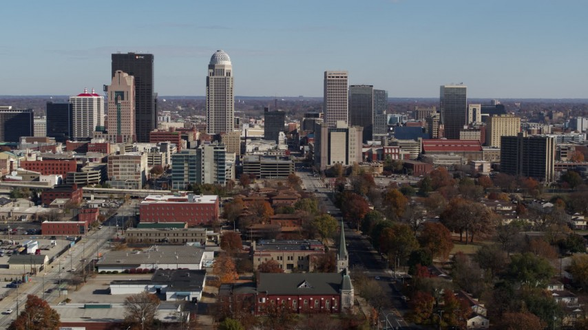 5.7K aerial video flying by the city's skyline, seen near churches in Downtown Louisville, Kentucky Aerial Stock Footage | DX0001_002984
