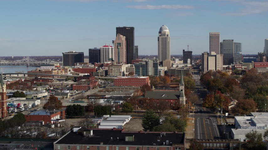 5.7K aerial video flyby and focus on skyscrapers in the city's skyline in Downtown Louisville, Kentucky Aerial Stock Footage | DX0001_002994