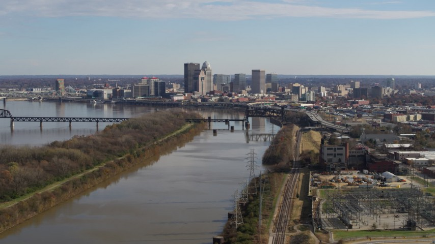 5.7K stock footage aerial video of the city's skyline seen while flying by the river in Downtown Louisville, Kentucky Aerial Stock Footage | DX0001_002999