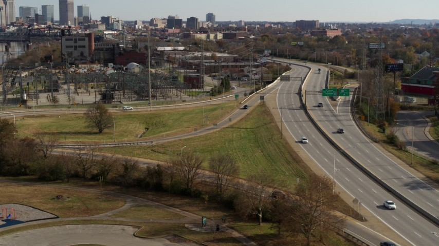5.7K stock footage aerial video track cars on a freeway in Louisville, Kentucky Aerial Stock Footage | DX0001_003005