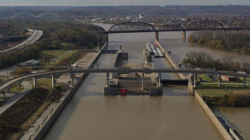 5.7K stock footage aerial video flying by locks and a dam on the Ohio River in Louisville, Kentucky Aerial Stock Footage | DX0001_003012