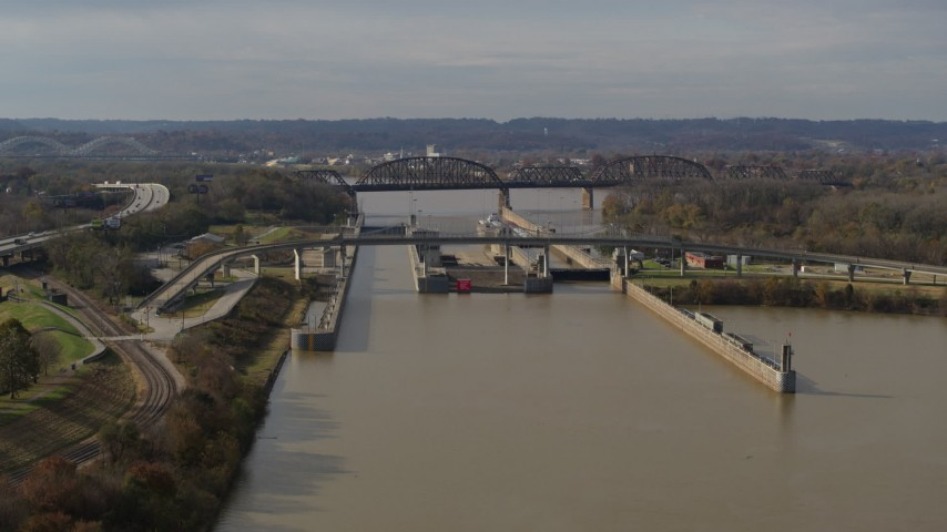 5.7K stock footage aerial video descend near locks and a dam on the Ohio River in Louisville, Kentucky Aerial Stock Footage | DX0001_003014