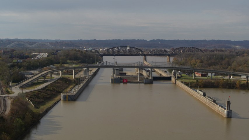 5.7K aerial video approach locks and a dam on the Ohio River before ascent in Louisville, Kentucky Aerial Stock Footage | DX0001_003015