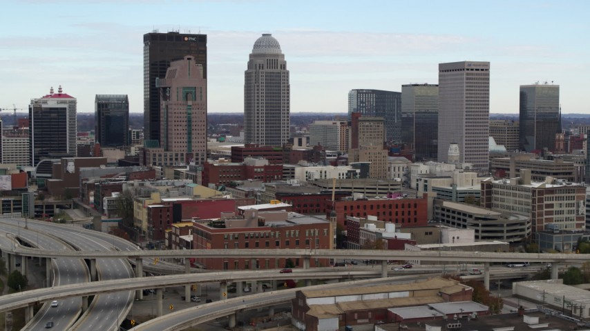 5.7K aerial video of city skyline seen from freeway offramp in Downtown Louisville, Kentucky Aerial Stock Footage | DX0001_003019