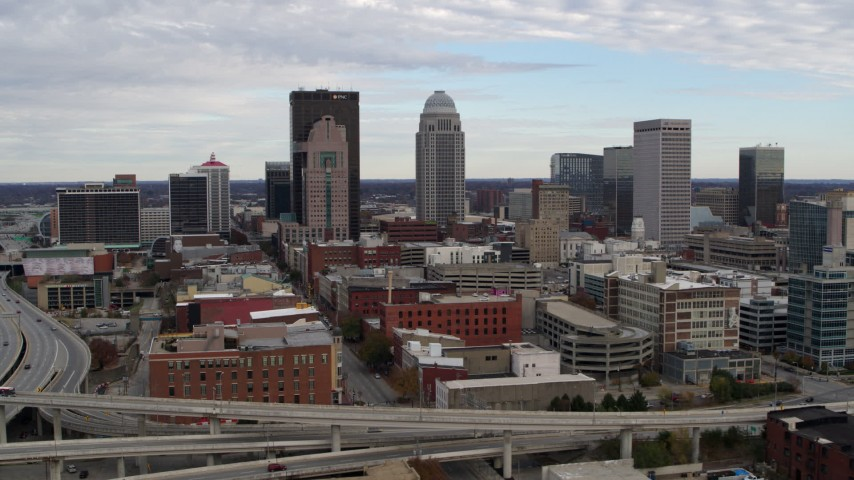 5.7K aerial video of a reverse view of the city's skyline seen from an offramp in Downtown Louisville, Kentucky Aerial Stock Footage | DX0001_003027