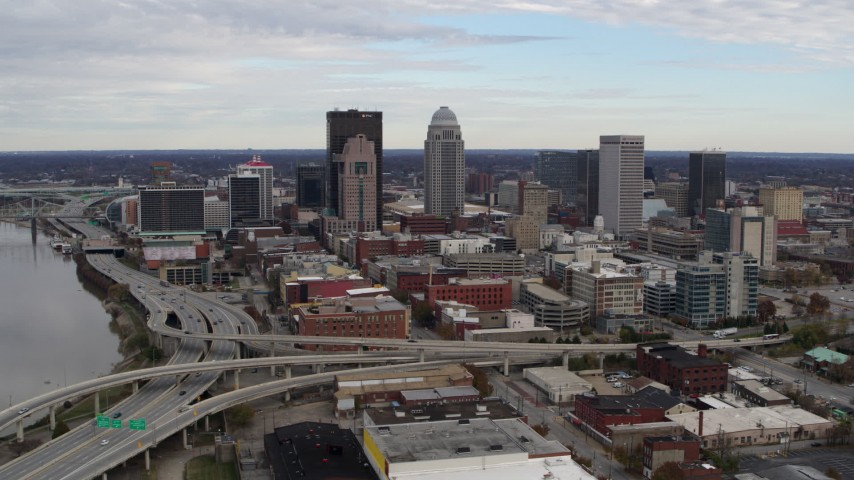 5.7K aerial video fly away from the city's skyline beside a freeway in Downtown Louisville, Kentucky Aerial Stock Footage | DX0001_003028