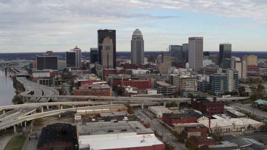 5.7K aerial video flyby the city's skyline beside a freeway in Downtown Louisville, Kentucky before approach Aerial Stock Footage | DX0001_003029