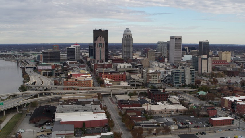 5.7K aerial video slowly approach tall skyscrapers in city skyline in Downtown Louisville, Kentucky Aerial Stock Footage DX0001_003033