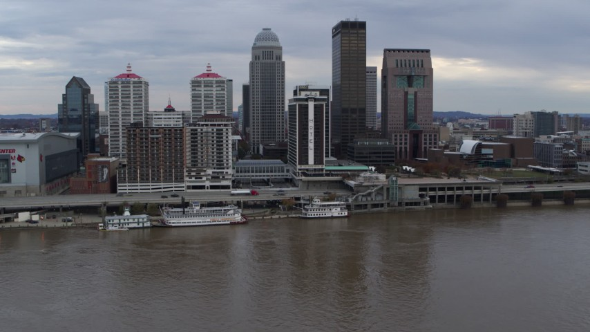 5.7K stock footage aerial video of hotel and skyline seen from the river in Downtown Louisville, Kentucky Aerial Stock Footage | DX0001_003038