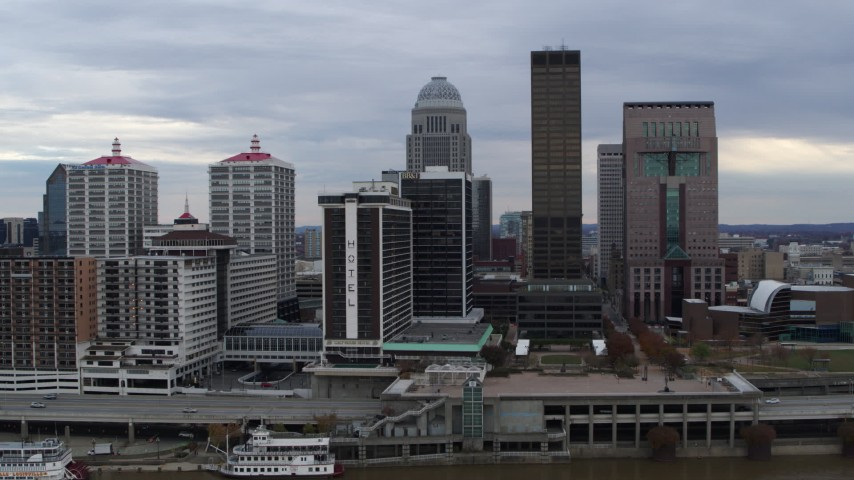 5.7K aerial video approach hotel and the skyline from the river in Downtown Louisville, Kentucky Aerial Stock Footage DX0001_003040
