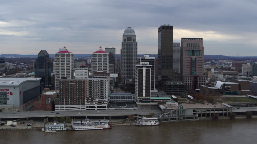 5.7K aerial video fly away from riverfront hotel and skyline, reveal the river in Downtown Louisville, Kentucky Aerial Stock Footage DX0001_003041