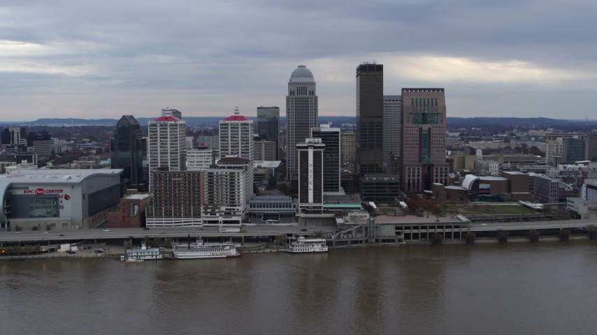 5.7K stock footage aerial video of flying by the city skyline beside the river in Downtown Louisville, Kentucky Aerial Stock Footage | DX0001_003042