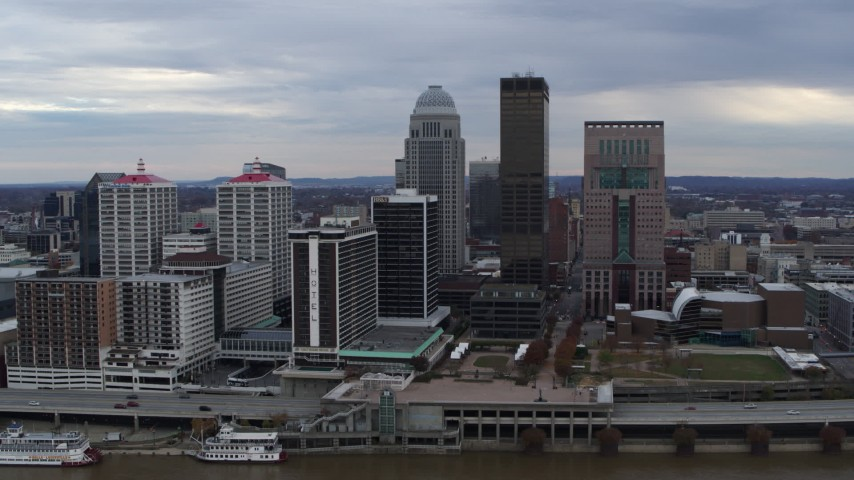 5.7K stock footage aerial video approach riverfront hotel and the city skyline from the river in Downtown Louisville, Kentucky Aerial Stock Footage | DX0001_003043