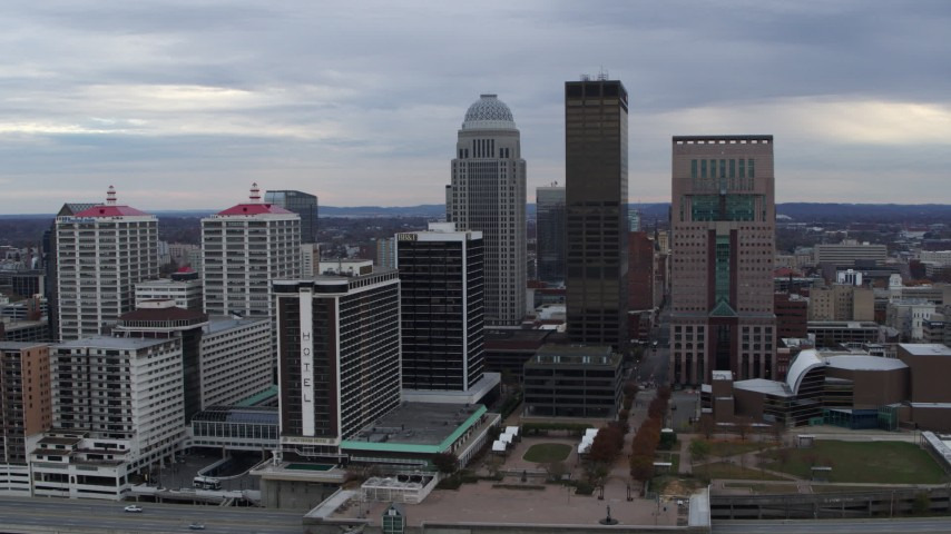 5.7K aerial video reverse view of riverfront hotel and the city skyline, reveal the river in Downtown Louisville, Kentucky Aerial Stock Footage | DX0001_003044