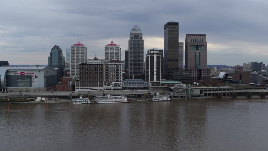 5.7K stock footage aerial video descend and flyby the city skyline and Ohio River in Downtown Louisville, Kentucky Aerial Stock Footage | DX0001_003045