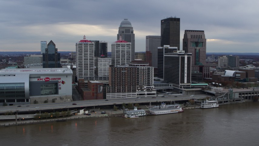 5.7K stock footage aerial video stationary view of the city skyline beside the Ohio River in Downtown Louisville, Kentucky Aerial Stock Footage | DX0001_003047