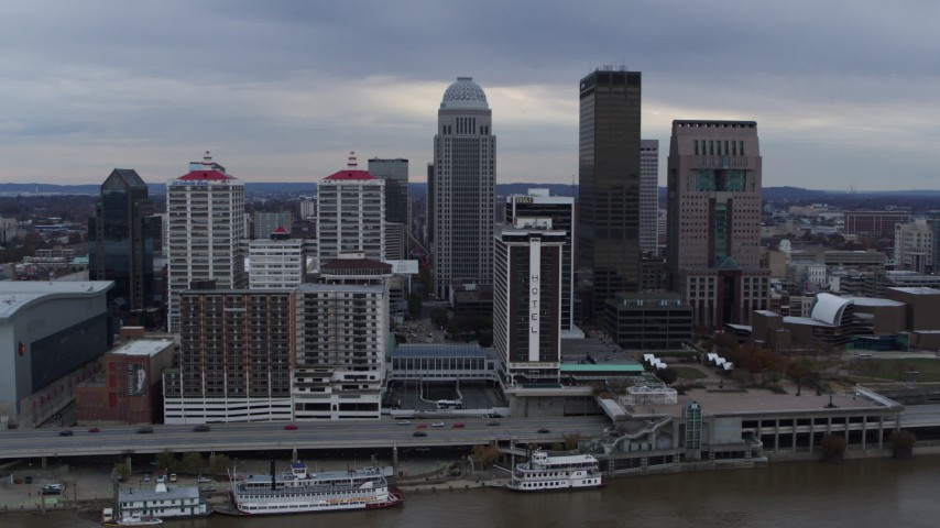 5.7K stock footage aerial video reverse view of skyline and hotel, revealing the Ohio River in Downtown Louisville, Kentucky Aerial Stock Footage | DX0001_003050