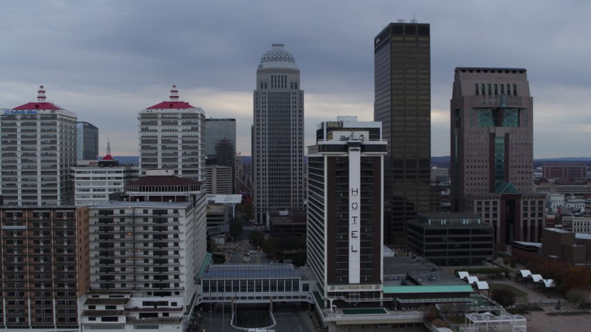5.7K stock footage aerial video fly away from skyscrapers behind riverfront hotel in Downtown Louisville, Kentucky Aerial Stock Footage | DX0001_003052
