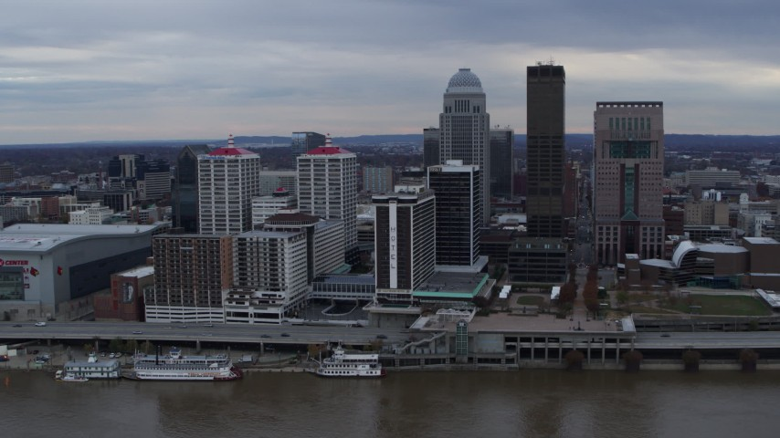 5.7K aerial video slowly fly away from riverfront buildings and skyline in Downtown Louisville, Kentucky Aerial Stock Footage | DX0001_003053