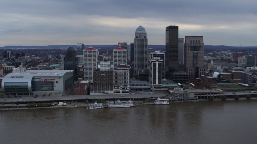 5.7K aerial video slowly flyby riverfront buildings and skyline, seen from Ohio River in Downtown Louisville, Kentucky Aerial Stock Footage DX0001_003054