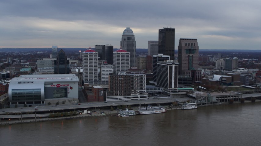 5.7K aerial video fly over river to approach riverfront hotel and skyline, Downtown Louisville, Kentucky Aerial Stock Footage | DX0001_003055