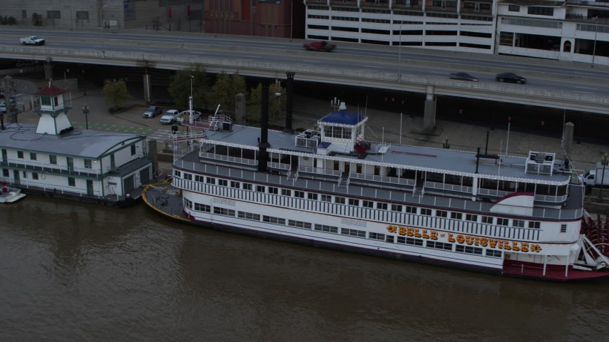 5.7K aerial video close-up view of the historic riverboat docked by Downtown Louisville, Kentucky Aerial Stock Footage | DX0001_003064