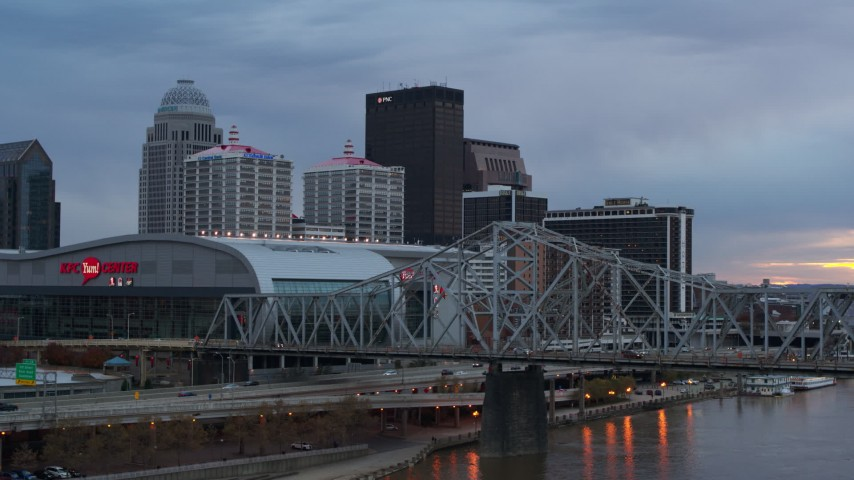 5.7K stock footage aerial video view of arena and city skyline at sunset from the bridge, Downtown Louisville, Kentucky Aerial Stock Footage | DX0001_003079