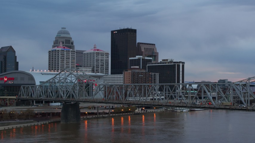5.7K stock footage aerial video view of city skyline at sunset while passing the bridge, Downtown Louisville, Kentucky Aerial Stock Footage | DX0001_003080