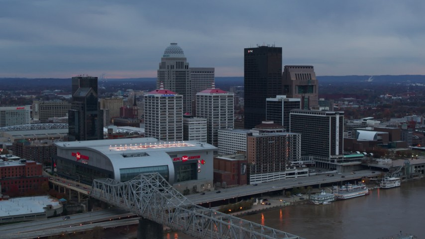 5.7K aerial video fly toward arena and city skyline at sunset from the bridge, Downtown Louisville, Kentucky Aerial Stock Footage | DX0001_003082